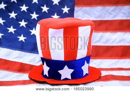 An American Flag Top Hat sits upon an American Flag Background.