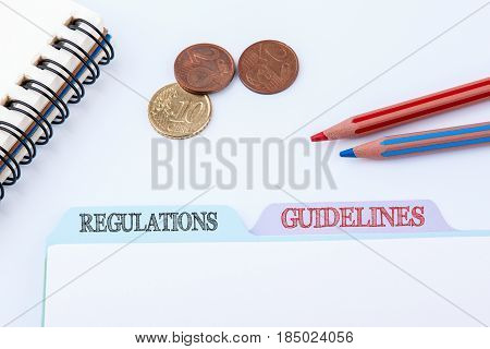 Regulations and Guidelines. Folder Register on a white Office Table.