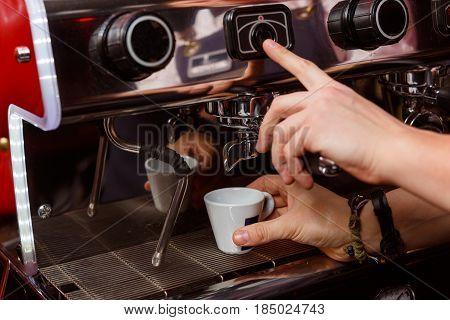 Bartender making coffee in pub bar restaurant