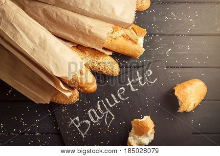 French Baguettes With Sesame Seed On Black Wooden Background
