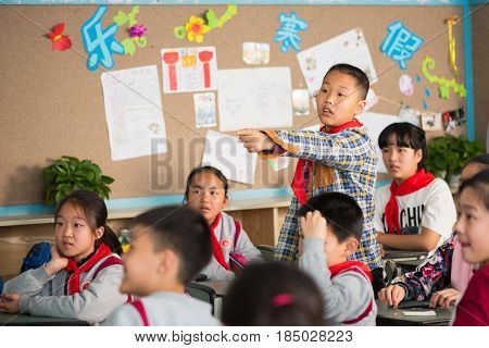 Schoolboy Pointing His Finger In A Chinese School