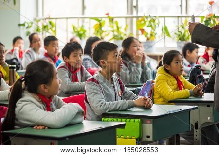 Teacher Giving A Lesson To Children In A Chinese Classroom