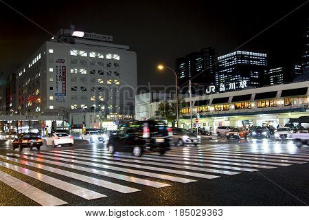 JAPAN, TOKYO, APRIL, 02, 2017 - Night traffic on the streets of Tokyo near Shinagawa Station  Shinagawa-eki is a major railway station in Tokyo, Japan.