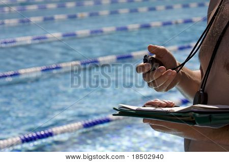 Trainer is standing at the pool
