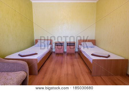 Sleeps - Bed And Two Bedside Tables In The Interior Of The Guest Room In The House, Close-up