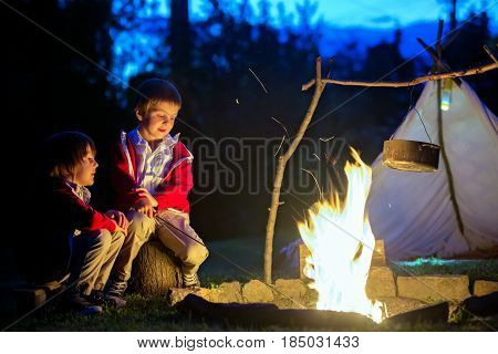 Two Sweet Boys, Sitting Around The Campfire After Sunset