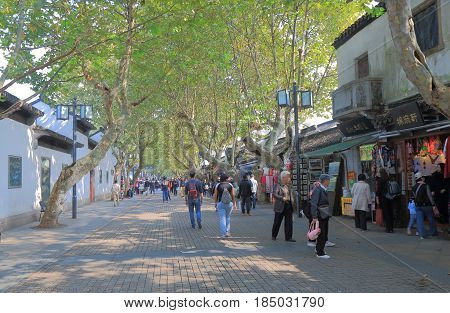 SUZHOU CHINA - NOVEMBER 3, 2016: Unidentified people visit souvenir shopping street in front of Humble Administrators Garden.