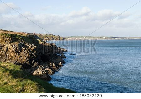 Looking at Tramore Beach Resort Town From Far Away Green Grassy Cliffs