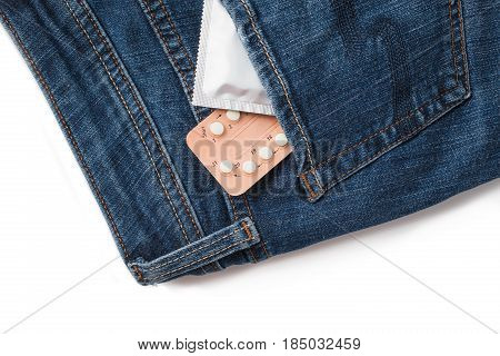 Condoms In Package In Jeans. Safe Sex Concept. Healthcare Medicine, Contraception And Birth Control.