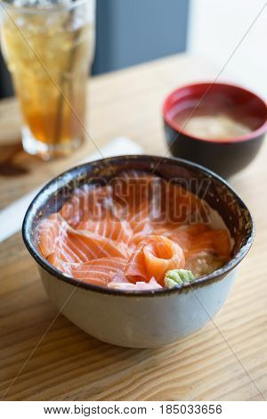 Salmon Donburi serve with miso soup on wooden table Japanese food