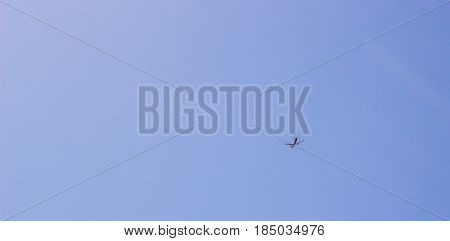 One plane flies across the sky airfreight air transport