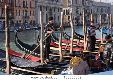 Gondoliers On The Grand Canal In Venice, Italy