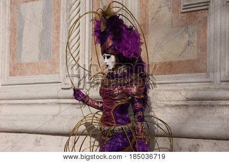 Woman In Costume And Mask Posing At The Venice Carnival In Venice, Italy