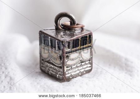 Miniature of Kaabah on a white background