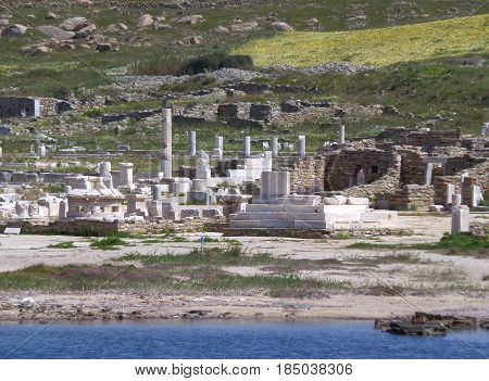 The Remains at Archaeological Site of Delos as seen from the ferry, Delos Island, Mykonos, Greece