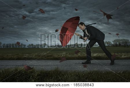 Crisis trouble problems concept. Businessman walks in the storm with copy space
