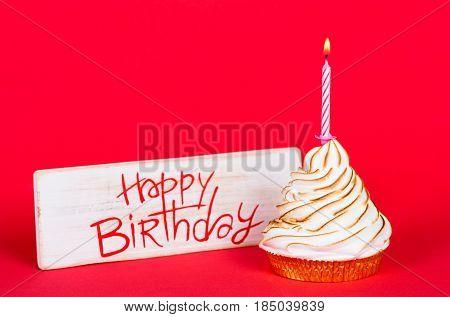 Happy birthday next to a cake to celebrate