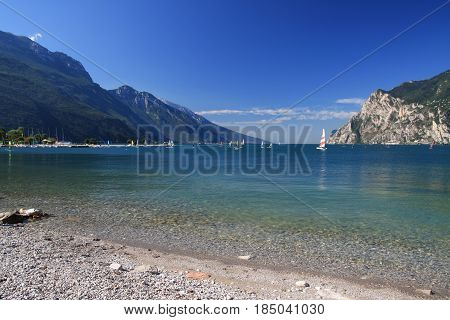Limpid Waters Of The Garda Lake In Italy, Surrounded By The Alps