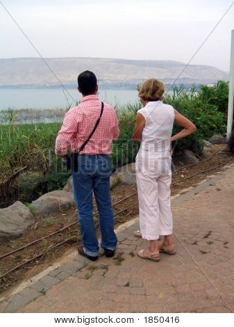 Tourists Looking At The Sea