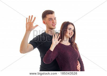 smiling young guy with a girl holding hands at the top with the Palms is isolated on a white background