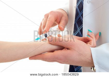 young doctor does prick filler girl close-up isolated on white background