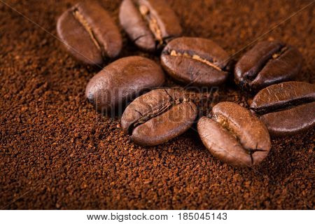 roasted coffee beans isolated in white background. Roasted coffee beans background close up. Coffee beans pile on the background of ground coffee with copy space for text. Good morning.