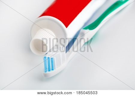 Toothbrush And Toothpaste Isolated On White. Dental Floss. Health And Dental Hygiene. Personal Hygie