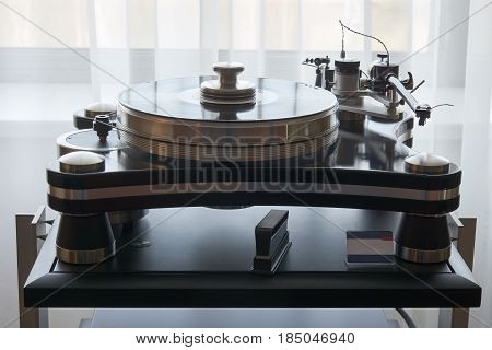High end turntable in the room near the window