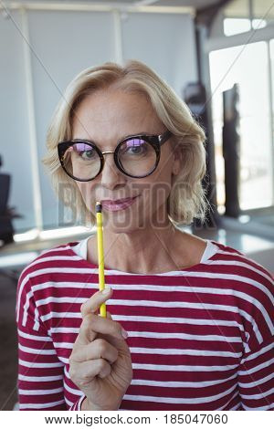 Portrait of entrepreneur wearing eyeglasses at office