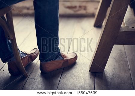 Adult Man Legs Feet by the Wooden Floor