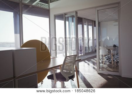 Empty chairs and table modern office on sunny day