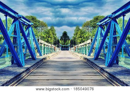 In the spirit of symmetry, a bridge over the river with dramatic clouds