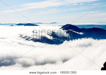 Clouds In The Mountains Lit By The Sun. The View From The Top.