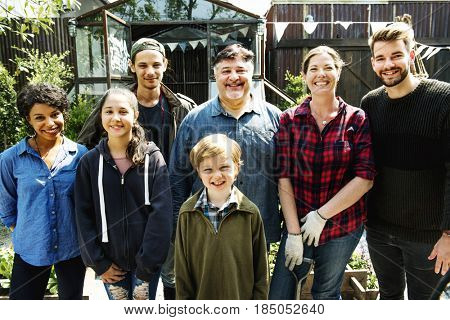 Group of people gardening backyard together