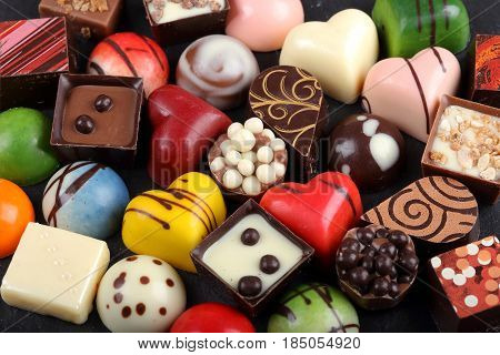 Assortment of sweet confectionery with chocolate candies and pralines.