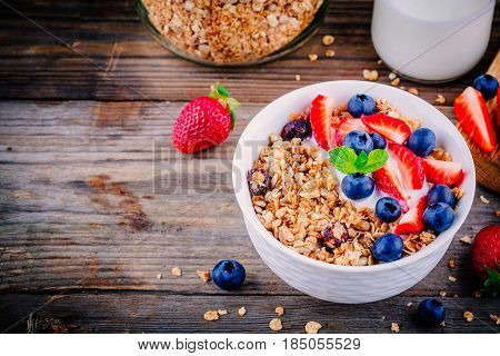 Healthy Breakfast: Bowl Of Granola With Yogurt And Berries
