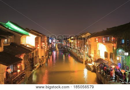 SUZHOU CHINA - NOVEMBER 3, 2016: Unidentified people visit historical canal in Suzhou