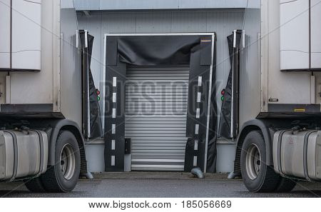 Two Trucks for unloading or loading at the depot of a forwarding company.