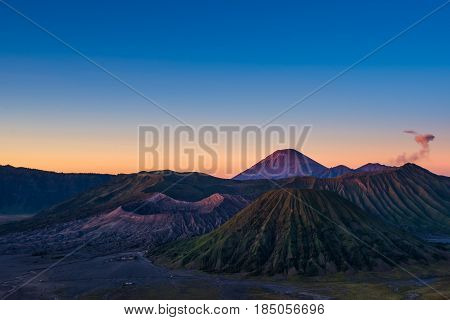 Mount Bromo volcano (Gunung Bromo) Eruption view from viewpoint on Mount Penanjakan. Mount Bromo located in Bromo Tengger Semeru National Park, East Java, Indonesia.