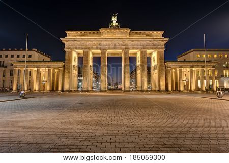 The famous Brandenburg Gate in Berlin illuminated at night