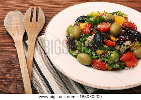 Tuna salad with cherry tomatoes, beans and olives. Low fat eating concept.