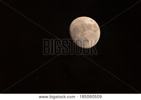 A Waning moon isolated on black background