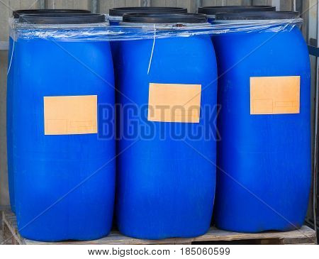 Scratched Blue Packed Barrels With Light Orange Labels