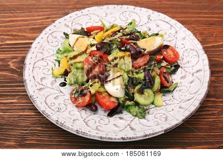 Salad with tuna, egg, tomato and beans. Low fat healthy eating concept.