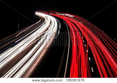 Highway at night with blurred car lights in a long exposure shot