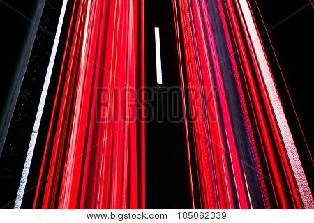 Long trails of car lights on a motorway at night