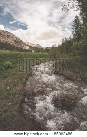 Flowing Transparent Waters On High Altitude Alpine Stream In Idyllic Uncontaminated Environment In T