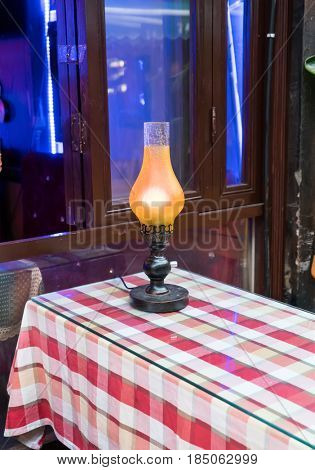 A kerosene lamp on the table