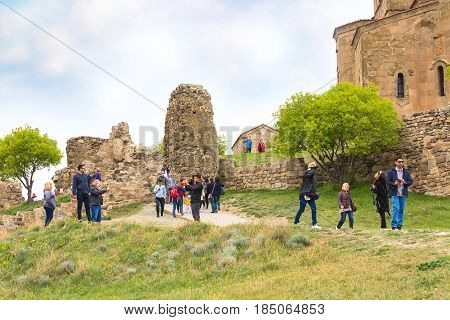 Mtskheta, Georgia - April 28, 2017: People near Jvari Orthodox monastery on the hill near Mtskheta, eastern Georgia