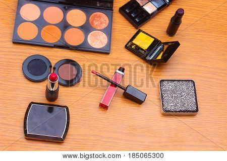 Makeup Palettes And Cosmetics Professional Brushes On A Wooden Background